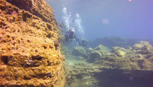 Scuba diving in White Island wall, Santorini in Greece