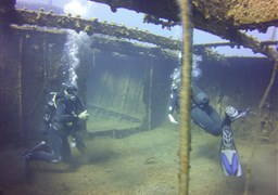 Scuba diving in Old Cargo Wreck in Greece